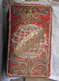 Whole Booke of Psalmes (1627) in what appears to be a contemporary binding of silver and gold thread embroidery on red silk